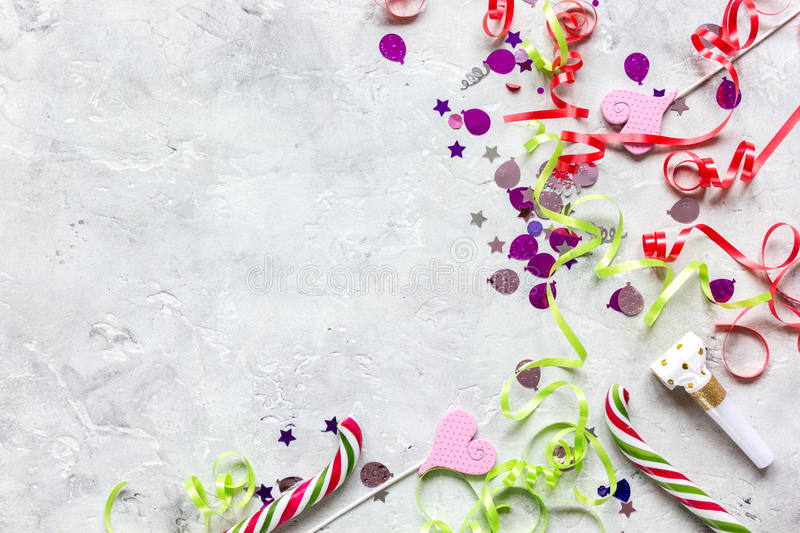 Birthday party design with confetti top view space for text. Birthday party design with colorful confetti on stone table background top view space for text royalty free stock photos