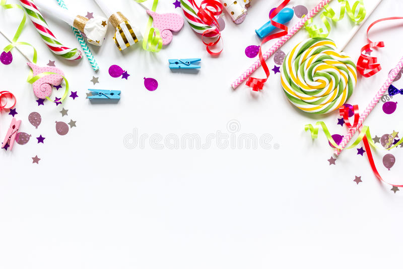 Birthday party design with confetti top view space for text. Birthday party design with colorful confetti on white table background top view space for text stock images