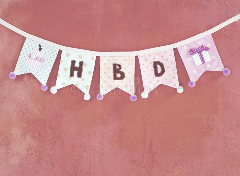 Birthday party flag design idea, design fabric party flag on pink texture background. Vintage tone style royalty free stock image