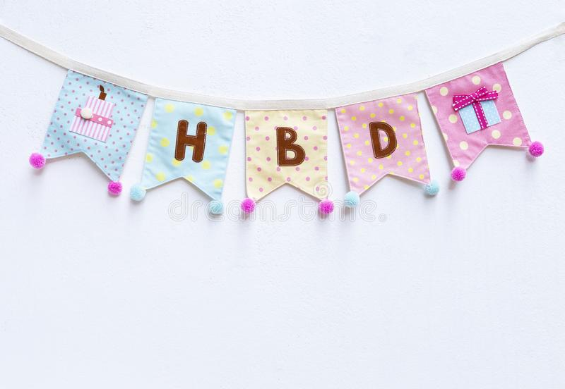 Birthday party flag on white cement wall texture background royalty free stock photography