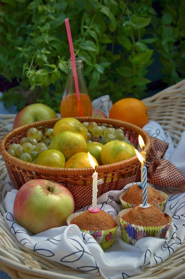 Birthday party in garden - muffins, fruits and juice royalty free stock photos