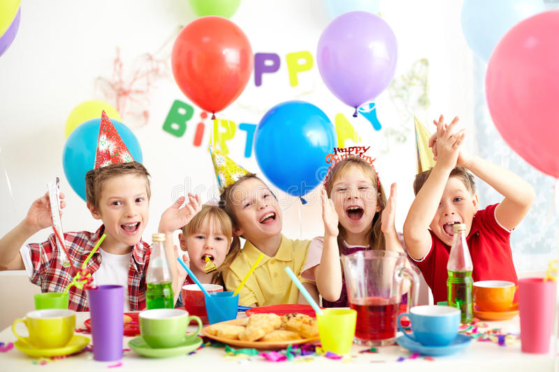 Birthday party. Group of adorable kids having fun at birthday party stock photos