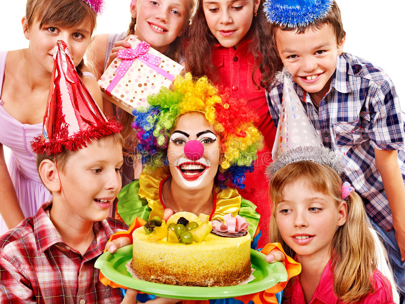 Birthday party group of child with cake. Birthday party of group teen with clown and cake. Isolated stock photo
