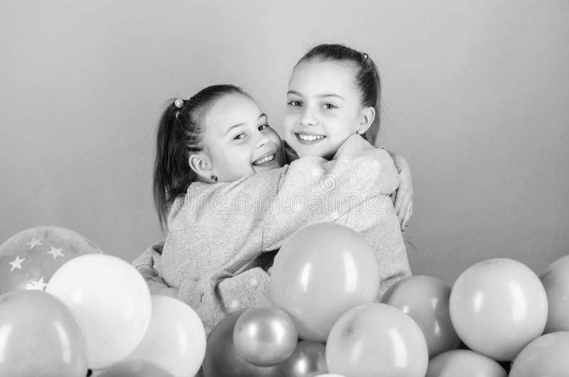 Birthday party. Happiness and cheerful moments. Carefree childhood. Start this party. Sisters organize home party. Having fun concept. Balloon theme party royalty free stock photography