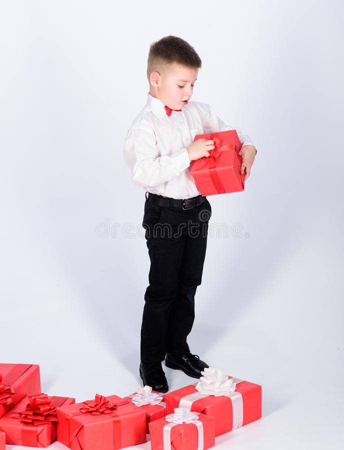 Birthday party. happy child with present box. Christmas. little boy with valentines day gift. Shopping. Boxing day. New. Year. tuxedo style. Happy childhood. go royalty free stock photography