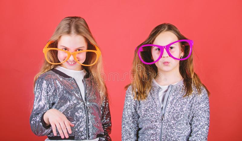 Birthday party. Happy childhood. Sincere cheerful kids share happiness and love. Joyful and cheerful. Sisterhood concept. Friendly relations siblings. Girls royalty free stock image