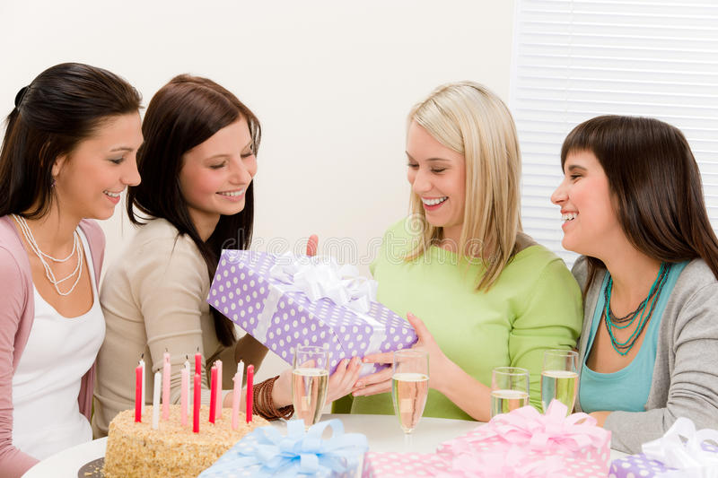 Birthday party - happy woman getting present. Champagne, cake royalty free stock photos