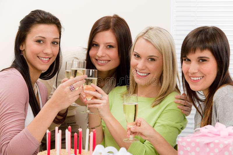 Birthday party - happy woman toast with champagne. Present, cake royalty free stock image
