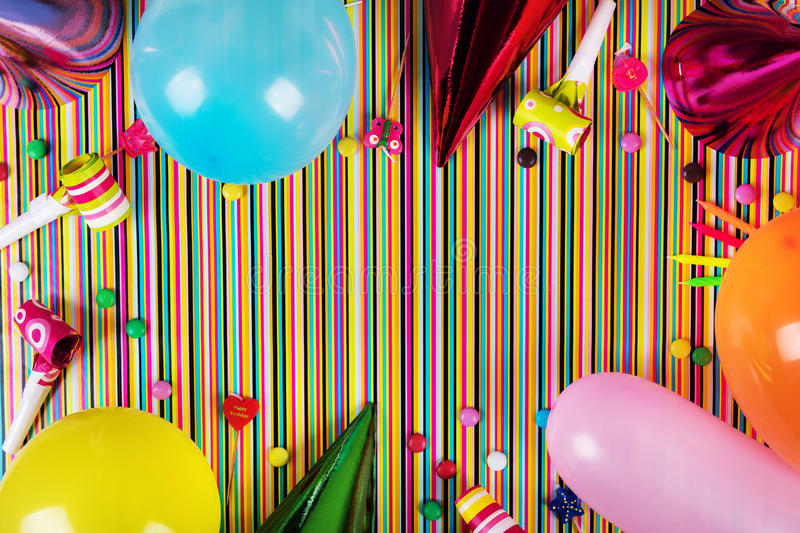 Birthday party items on striped background with copy space. Top view stock image