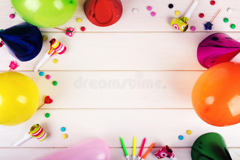 Birthday party items on white wooden background. Top view royalty free stock images