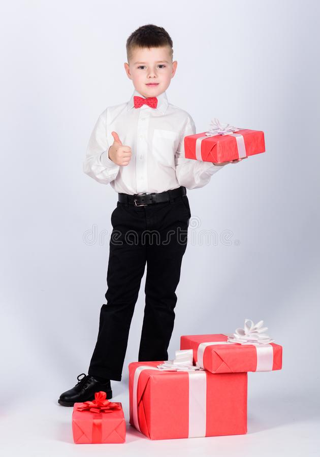 Birthday party. little boy with valentines day gift. Shopping. Boxing day. New year. tuxedo style. Happy childhood. Happy child with present box. Christmas stock image