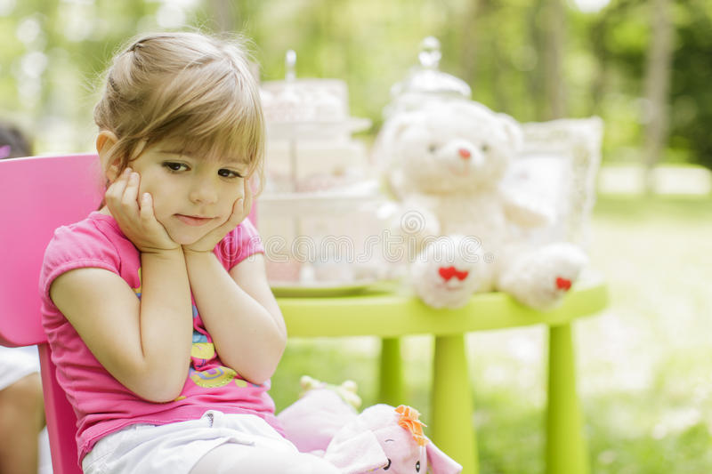 Birthday party. Little girl at the birthday party royalty free stock photo