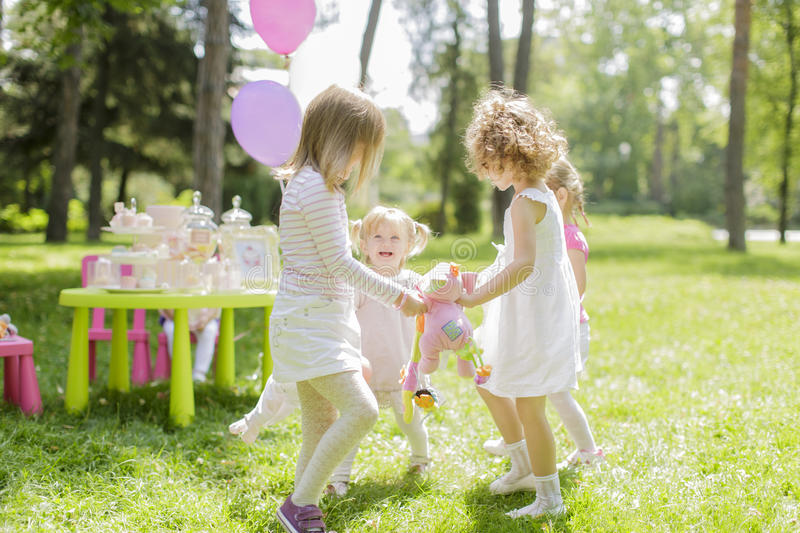 Birthday party. Little girls playing at the birthday party royalty free stock photo