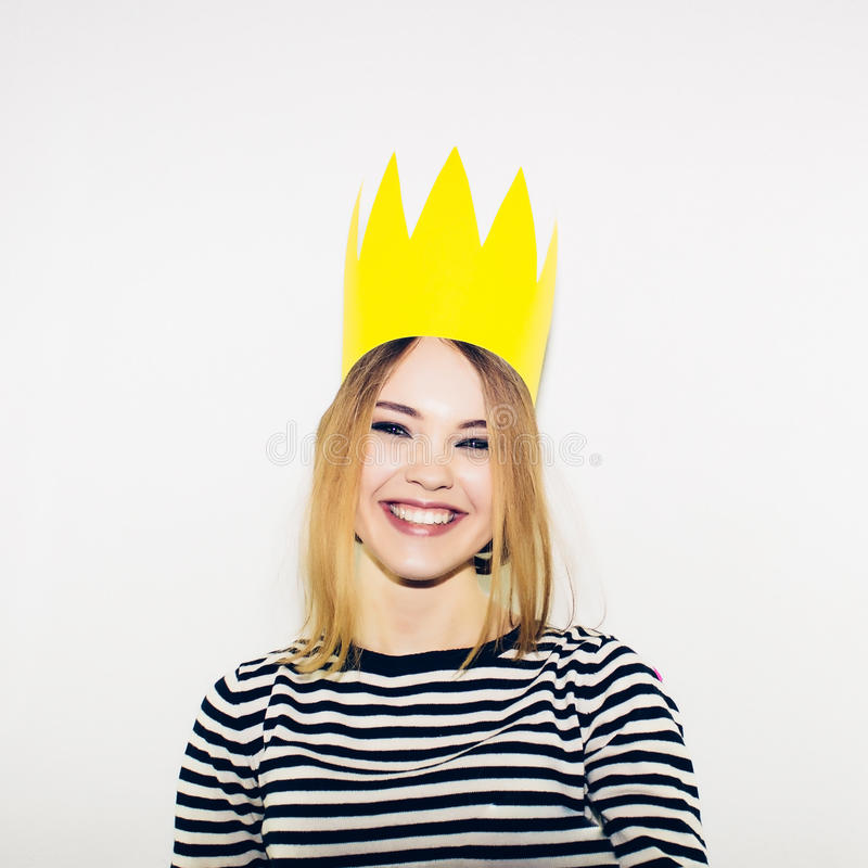 Birthday party, new year carnival. Young smiling woman on white background celebrating brightful event, wears stripped stock photos