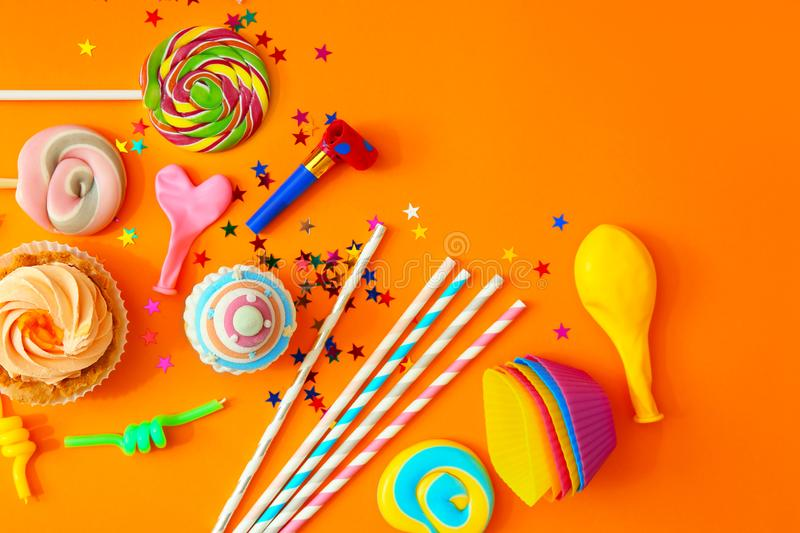 Birthday party objects on orange background,. Top view stock image