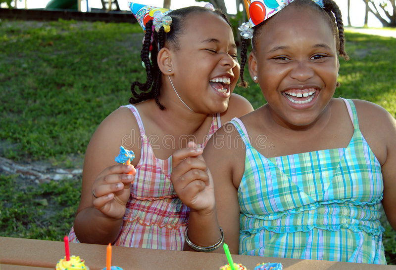Birthday party sisters. Two african american sisters at a birthday party stock photos