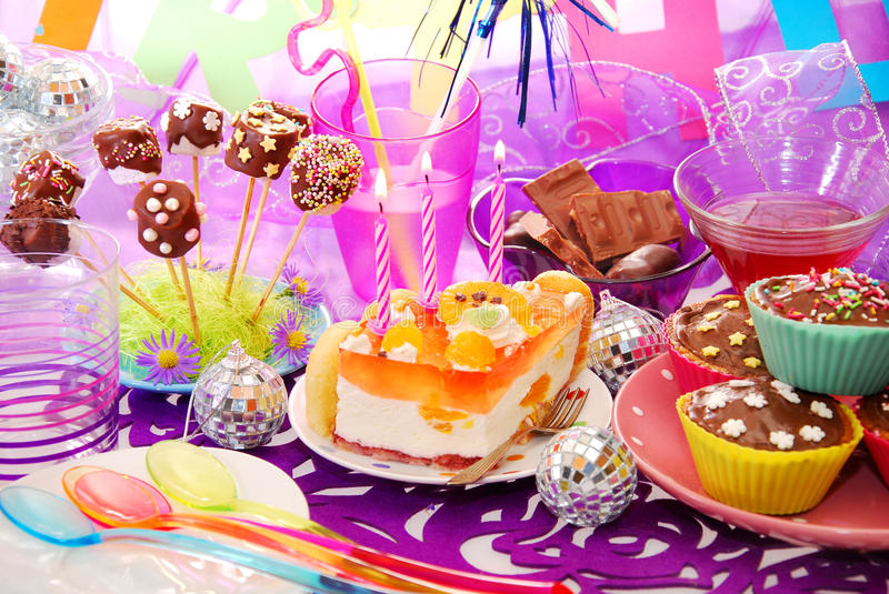 Birthday party table with sweets for child stock photos