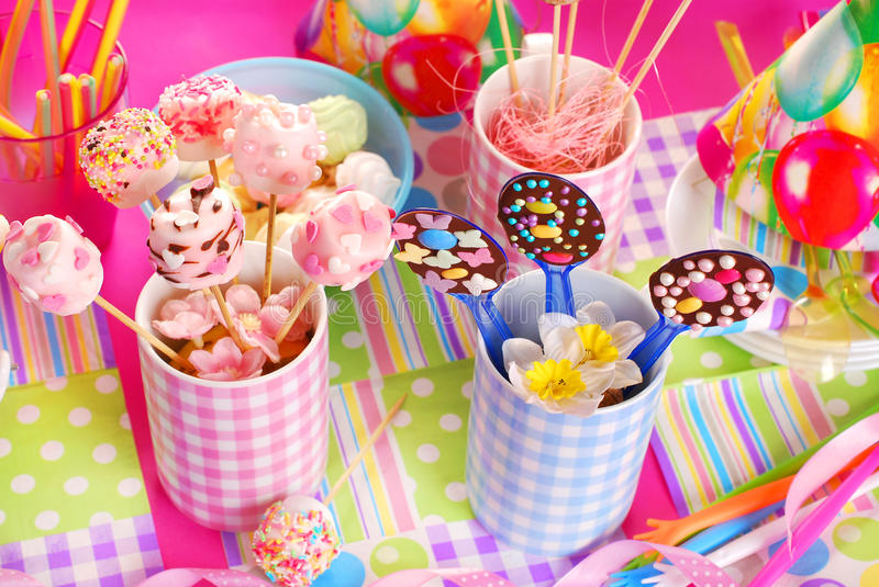 Birthday party table with sweets for kids stock image