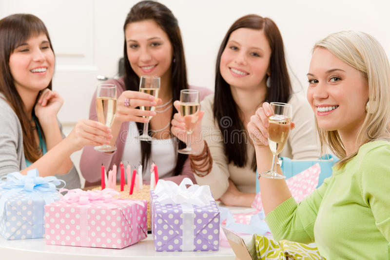 Birthday party - woman drink champagne royalty free stock image