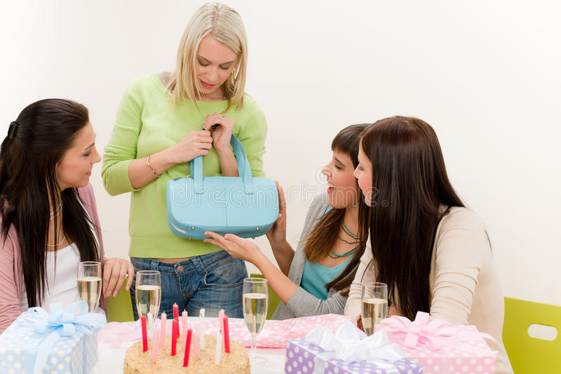 Birthday party - woman getting present. Celebrate with cake and champagne royalty free stock image