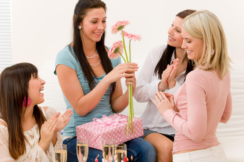 Birthday party - woman getting present and flower. Surprise stock images