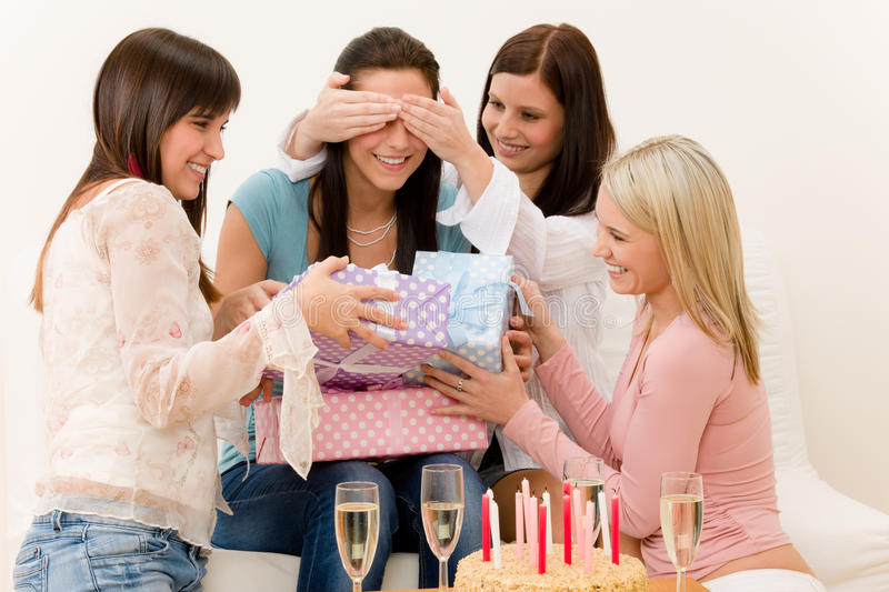 Birthday party - woman getting present, surprise royalty free stock image