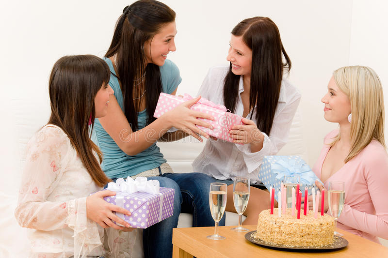 Birthday party - woman getting present, surprise royalty free stock photo