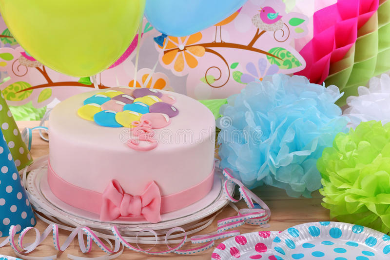 Birthday pink cake and balloons on party or reception.  stock image