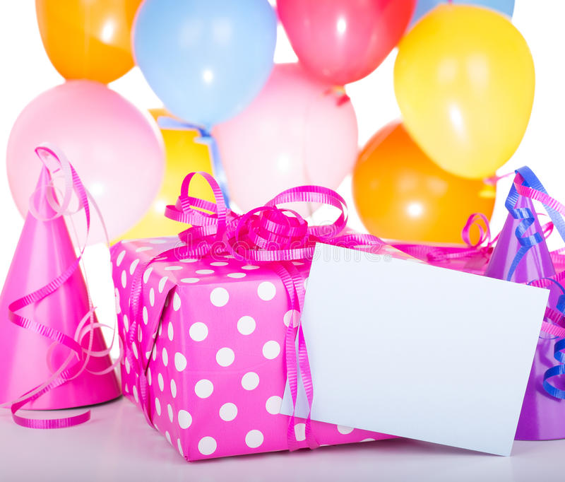 Birthday Present. And blank envelope with hats and balloons on a white background royalty free stock photos