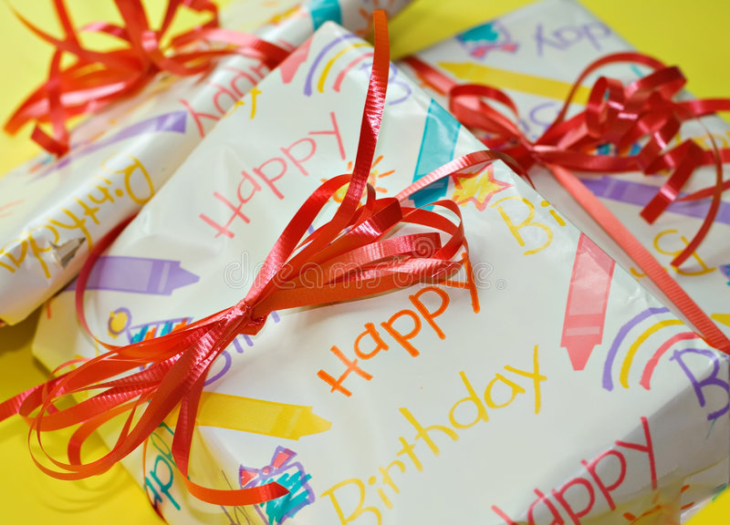 Birthday Presents. Brightly wrapped birthday packages with red bows stock image