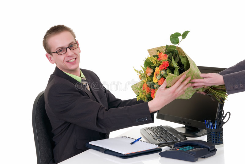 Birthday, promotion flowers. Handsome young successful businessman getting flowers for birthday, promotion, white background, studio shot royalty free stock photography