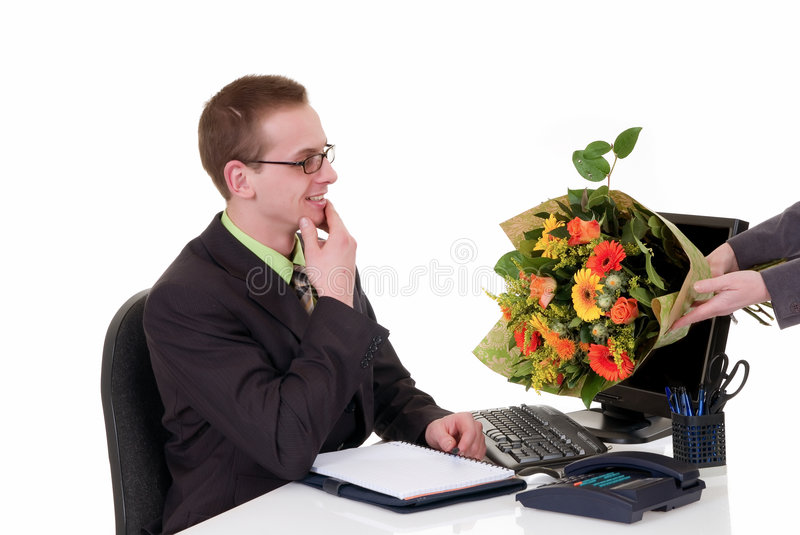 Birthday, promotion flowers. Handsome young successful businessman getting flowers for birthday, promotion, white background, studio shot royalty free stock photos