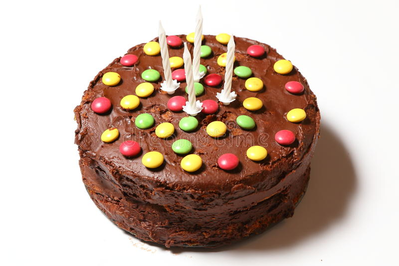 Birthday rounded chocolate cake with four candles stock photos