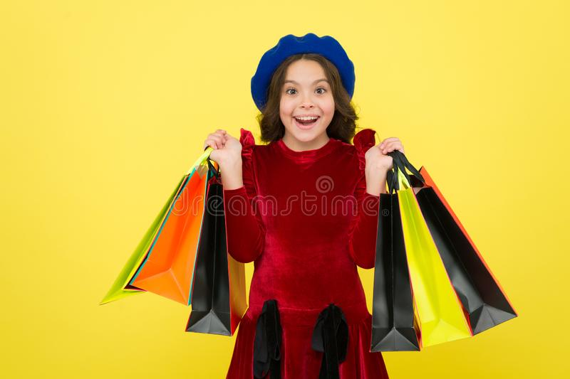 Birthday shopping concept. Child cute small girl on shopping tour. Best price. Buy now. Visit shopping mall. All i want. For my birthday. Kid girl hold bunch royalty free stock images