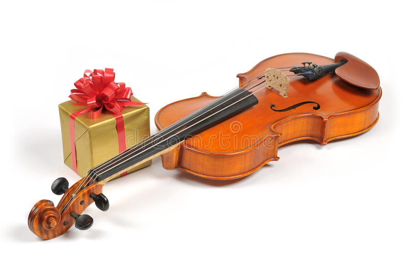 Birthday surprise. Violin and gifts royalty free stock photo