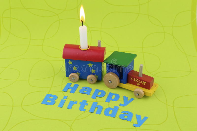 Birthday Train. With candle and lettering on a green background royalty free stock photos