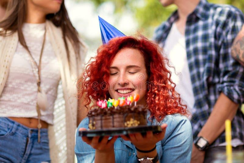 Birthday make wish. Cute birthday female hold cake and make wish stock image