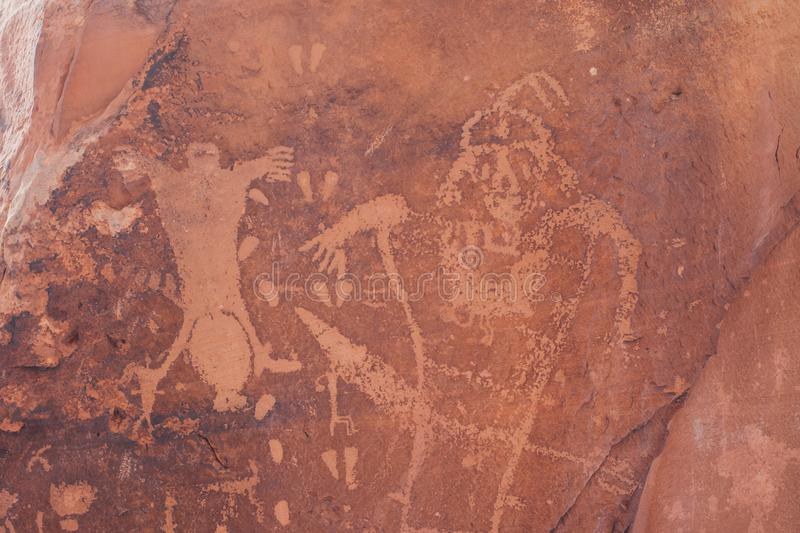 The Birthing Scene Petroglyph in Moab, Utah. Petroglyphs in Moab, Utah known as `The Birthing Scene.` This image depicts the petroglyph from where the rock gets royalty free stock image