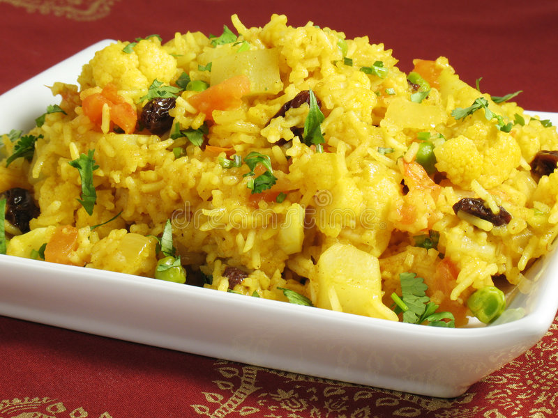 Biryani. A colorful Indian rice dish made from basmati rices, spices, and fresh vegetables royalty free stock photos