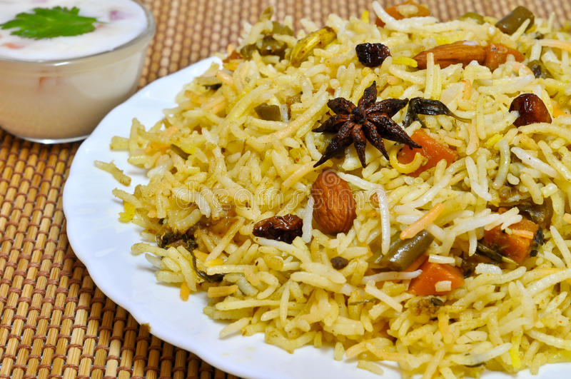 Biryani Rice. A colorful Indian rice dish made from basmati rices, spices, and fresh vegetables stock photos