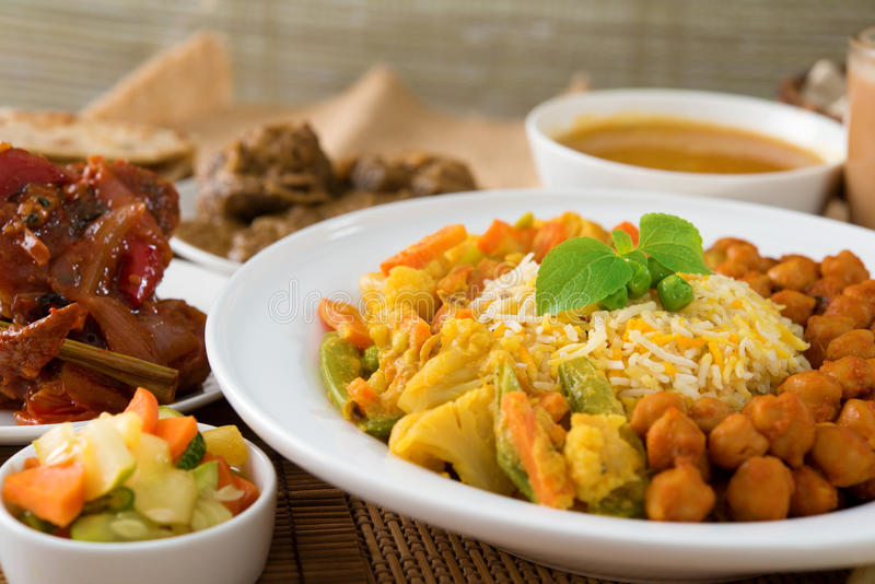Biryani rice. Or pilau rice with curry, fresh cooked basmati rice with spices, delicious Indian food stock images