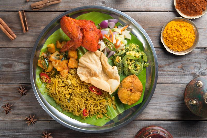 Biryani rice with setting. Overhead view of full length Indian biryani rice on wooden dining table background royalty free stock photography
