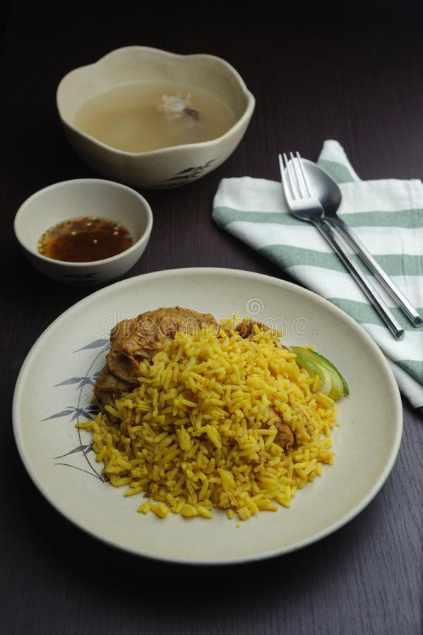 Biryani is a South Asian mixed rice dish. Muslim yellow rice with chicken royalty free stock photo