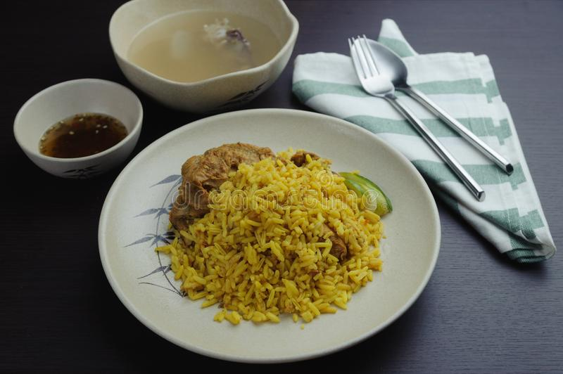 Biryani is a South Asian mixed rice dish. Muslim yellow rice with chicken royalty free stock photos