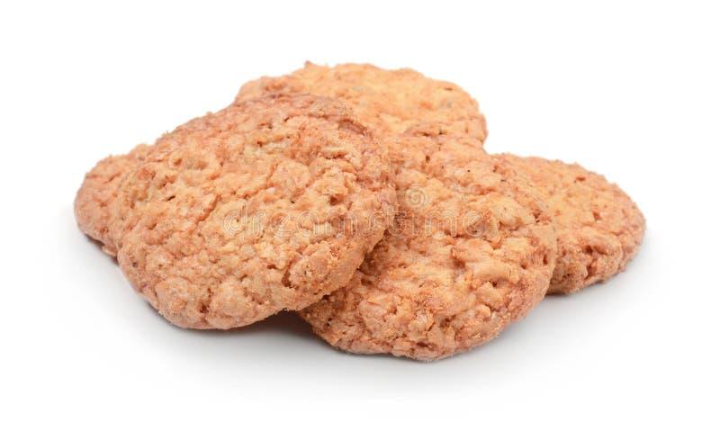 Biscoitos de farinha de aveia isolados no branco foto de stock royalty free