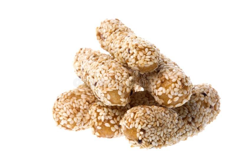 Biscoitos do sésamo isolados foto de stock royalty free