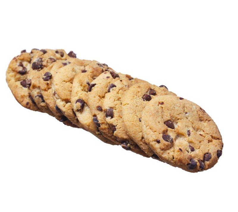 Biscoitos dos pedaços de chocolate isolados no branco. Biscoitos caseiros da pastelaria fotos de stock