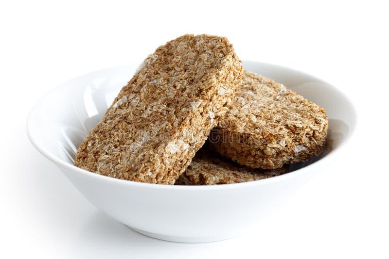 Biscoitos inteiros do café da manhã do trigo imagem de stock royalty free