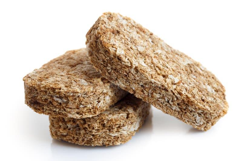 Biscoitos inteiros do café da manhã do trigo fotos de stock