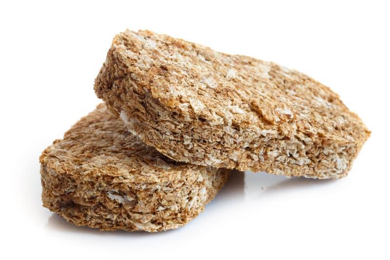 Biscoitos inteiros do café da manhã do trigo fotos de stock royalty free